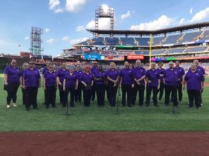 Choir group standing in the field at the Phillies stadium