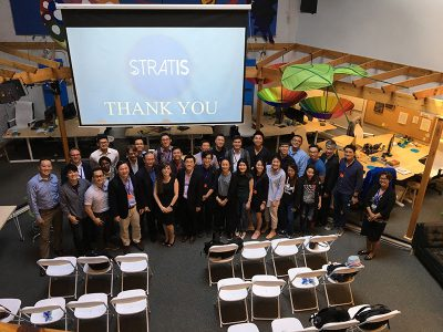 Group of visitors from Singapore posing together after the presentation