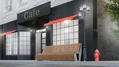 Cafe with black brick storefront and long bench in front