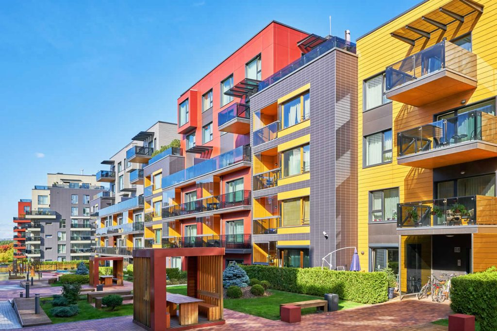 Multi-colored multifamily complex with balconies