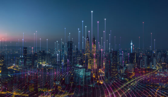 Skyline of a city at night with lines that show networking